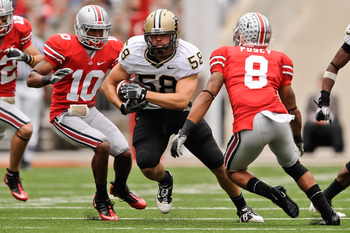COLUMBUS, OH - OCTOBER 23:  Robert Maci #58 of the Purdue Boilermakers returns an interception against the Ohio State Buckeyes at Ohio Stadium on October 23, 2010 in Columbus, Ohio.  (Photo by Jamie Sabau/Getty Images)