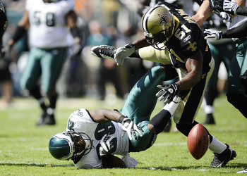 PHILADELPHIA - SEPTEMBER 20: LeSean McCoy #29 of the Philadelphia Eagles and Jonathan Vilma #51 of the New Orleans Saints scramble for a ball during their game at Lincoln Financial Field on September 20, 2009 in Philadelphia, Pennsylvania.  (Photo by Jeff