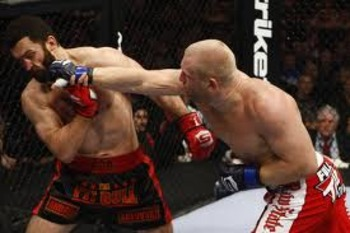 Sergei Kharitonov hammering Andrei Arlovski