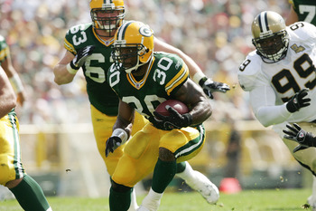 GREEN BAY, WI - SEPTEMBER 17:  Running back Ahman Green #30 of the Green Bay Packers runs with the ball during the game against the New Orleans Saints on September 17, 2006 at Lambeau Field in Green Bay, Wisconsin. The Saints defeated the Packers 34-27.