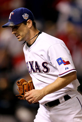 ARLINGTON, TX - NOVEMBER 01:  Cliff Lee #33 of the Texas Rangers runs back to the dugout at the end of an inning against the San Francisco Giants in Game Five of the 2010 MLB World Series at Rangers Ballpark in Arlington on November 1, 2010 in Arlington,