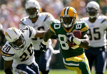 GREEN BAY, WI - SEPTEMBER 23:  Donald Driver #80 of the Green Bay Packers manuevers past Marlon McCree #20 of the San Diego Chargers after catching a pass at Lambeau Field September 23, 2007 in Green Bay, Wisconsin.  (Photo by Matthew Stockman/Getty Image