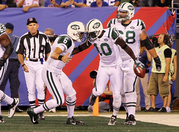 EAST RUTHERFORD, NJ - AUGUST 29:  Santonio Holmes #10 of the New York Jets celebrates his second quarter touchdown reception against the New York Giants with teammate Mark Sanchez during their pre season game on August 29, 2011 at MetLife Stadium in East