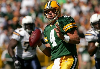 GREEN BAY, WI - SEPTEMBER 23:  Quarterback Brett Favre #4 of the Green Bay Packers is chased out of the pocket against the San Diego Chargers at Lambeau Field September 23, 2007 in Green Bay, Wisconsin.  (Photo by Matthew Stockman/Getty Images)