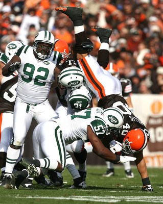 CLEVELAND - NOVEMBER 14:  Tailback Peyton Hillis #40 of the Cleveland Browns is hit by defenders Bart Scott #57 and Antonio Cromartie #31 of the New York Jets at Cleveland Browns Stadium on November 14, 2010 in Cleveland, Ohio.  (Photo by Matt Sullivan/Ge