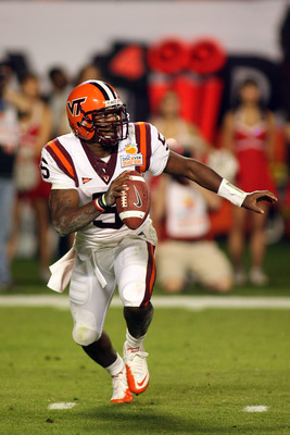 MIAMI, FL - JANUARY 03:  Tyrod Taylor #5 of the Virginia Tech Hokies looks to pass against the Stanford Cardinal during the 2011 Discover Orange Bowl at Sun Life Stadium on January 3, 2011 in Miami, Florida. Stanford won 40-12.  (Photo by Marc Serota/Gett