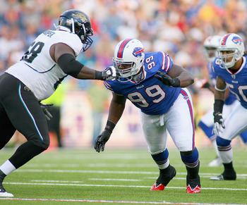 ORCHARD PARK, NY - AUGUST 27: Marcell Dareus #99 of the Buffalo Bills plays against Guy Whimper #68 of the Jacksonville Jaguars at Ralph Wilson Stadium on August 27, 2011 in Orchard Park, New York .Buffalo won 35-32 in overtime  (Photo by Rick Stewart/Get