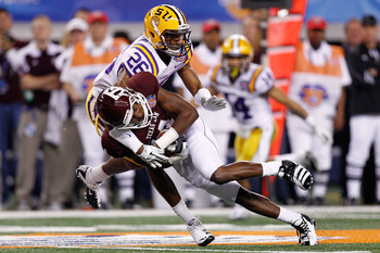ARLINGTON, TX - JANUARY 07:  Brandal Jackson #4 of the Texas A&M Aggies is tackled by Tharold Simon #26 of the Louisiana State University Tigers during the AT&T Cotton Bowl at Cowboys Stadium on January 7, 2011 in Arlington, Texas.  (Photo by Chris Grayth