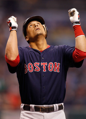 ST PETERSBURG, FL - AUGUST 27:  Catcher Victor Martinez #41 of the Boston Red Sox celebrates after his first inning home run against the Tampa Bay Rays during the game at Tropicana Field on August 27, 2010 in St. Petersburg, Florida.  (Photo by J. Meric/G