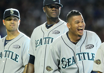 PHOENIX, AZ - JULY 12:  (R-L) American League All-Star Felix Hernandez #34 of the Seattle Mariners, American League All-Star Michael Pineda #36 of the Seattle Mariners and American League All-Star Brandon League #43 of the Seattle Mariners react during pl