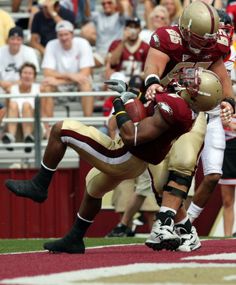 CHESTNUT HILL, MA - SEPTEMBER 05:  Montel Harris #2 of the Boston College Eagles scores a touchdown as teammate Matt Tennant #65 blocks in the first half against the Northeastern Huskies on September 5, 2009 at Alumni Stadium in Chestnut Hill, Massachuset