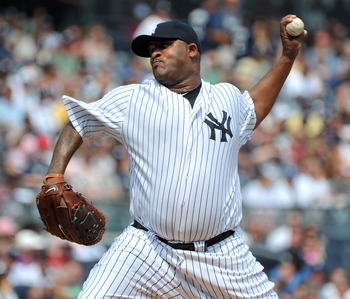 NEW YORK, NY - SEPTEMBER 04: CC Sabathia #52 of the New York Yankees throws a pitch in the top of the first inning against the Toronto Blue Jays on September 4, 2011 at Yankee Stadium in the Bronx borough of New York City. (Photo by Christopher Pasatieri/
