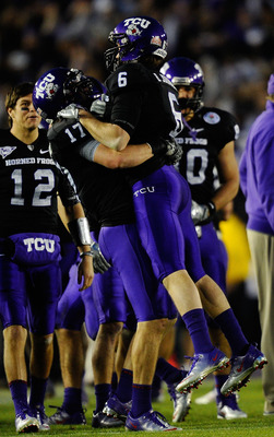 PASADENA, CA - JANUARY 01:  Safety Tyler Luttrell #17 of the TCU Horned Frogs celebrates with wide receiver Bart Johnson #6 in the final moments of their 21-19 win over the Wisconsin Badgers in the 97th Rose Bowl game on January 1, 2011 in Pasadena, Calif