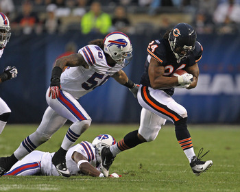 CHICAGO, IL - AUGUST 13:  Marion Barber #24 of the Chicago Bears runs for yardage past Nick Barnett #50 of the Buffalo Bills close in during a preseason game at Soldier Field on August 13, 2011 in Chicago, Illinois. The Bears defeated the Bills 10-3. (Pho