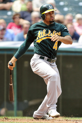 CLEVELAND, OH - SEPTEMBER 1: Coco Crisp #4 of the Oakland Athletics hits an RBI single during the fifth inning against the Cleveland Indians at Progressive Field on September 1, 2011 in Cleveland, Ohio. (Photo by Jason Miller/Getty Images)