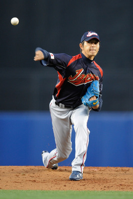 LOS ANGELES, CA - MARCH 23:  Starting pitcher Hisashi Iwakuma #20 of Japan delivers a pitch against Korea in the first inning of the finals of the 2009 World Baseball Classic on March 23, 2009 at Dodger Stadium in Los Angeles, California.  (Photo by Pool/