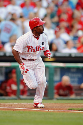PHILADELPHIA , PA - AUGUST 17:  Jimmy Rollins #11 of the Philadelphia Phillies watches his first inning homerun leave the park against the Arizona Diamondbacks at Citizens Bank Park on August 17, 2011 in Philadelphia, Pennsylvania.  (Photo by Len Redkoles