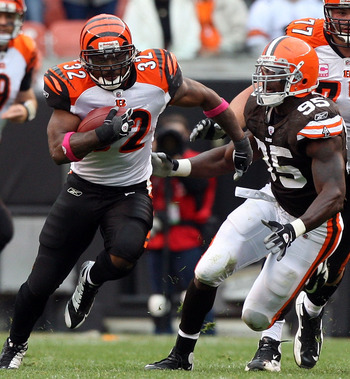 CLEVELAND - OCTOBER 04:  Cedric Benson #32 of the Cincinnati Bengals runs the ball against the Cleveland Browns during their game at Cleveland Browns Stadium on October 4, 2009 in Cleveland, Ohio. The Bengals defeated the Browns 23-20 in overtime.  (Photo