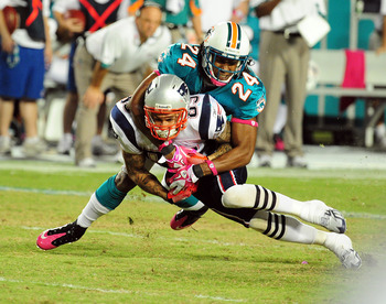 MIAMI - OCTOBER 4: Wes Welker #83 of the New England Patriots is tackled by Sean Smith #24 of the Miami Dolphins at Sun Life Field on October 4, 2010 in Miami, Florida. (Photo by Scott Cunningham/Getty Images)