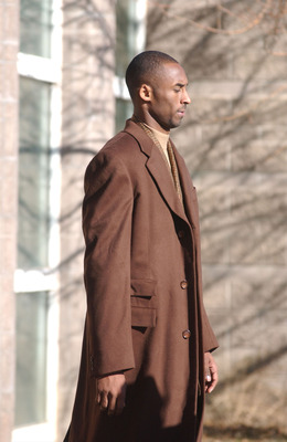 EAGLE, CO - DECEMBER 19: LA Lakers basketball star Kobe Bryant walks to a waiting vehicle during a break for lunch at the Eagle County Justice Center during the hearings on issues surrounding Bryant's sexual assault case December 19, 2003 in Eagle, Colora