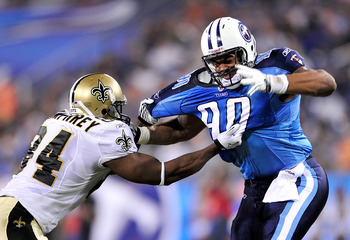 NASHVILLE, TN - SEPTEMBER 02:  Tory Humphrey #84 of the New Orleans Saints ties up Derrick Morgan #90 of the Tennessee Titans during the first half of an exhibition game at LP Field on September 2, 2010 in Nashville, Tennessee.  (Photo by Grant Halverson/