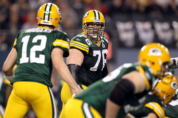 ARLINGTON, TX - FEBRUARY 06:  Chad Clifton #76 of the Green Bay Packers looks back at Aaron Rodgers #12 against the Pittsburgh Steelers during Super Bowl XLV at Cowboys Stadium on February 6, 2011 in Arlington, Texas.  (Photo by Jamie Squire/Getty Images)