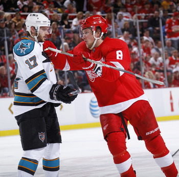 DETROIT - MAY 6: Torrey Mitchell #17 of the San Jose Sharks gets into an altercation with Justin Abdelkader #8 of the Detroit Red Wings in Game Four of the Western Conference Semifinals during the 2011 NHL Stanley Cup Playoffs on May 6, 2011 at Joe Louis