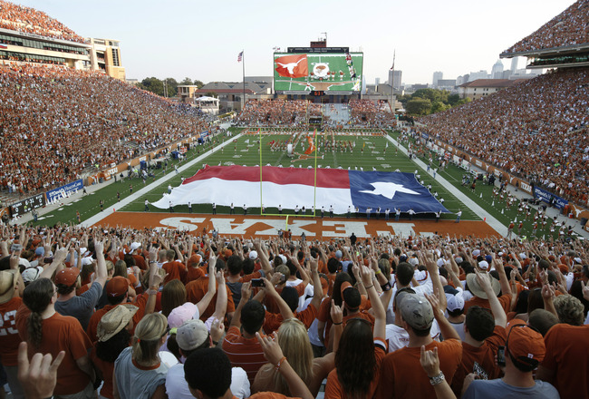 AUSTIN, TX - SEPTEMBER 3:  Fans sing 'The Eyes of Texas' before the start of the NCAA game between the Texas Longhorns and the Rice Owls on September 3, 2011 at Darrell K. Royal-Texas Memorial Stadium in Austin, Texas.  (Photo by Erich Schlegel/Getty Imag