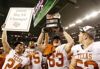 ARLINGTON, TX - DECEMBER 5: The Texas Longhorns celebrate their 10-6 victory over the Nebraska Cornhuskers in the game at Cowboys Stadium on December 5, 2009 in Arlington, Texas. (Photo by Ronald Martinez/Getty Images)
