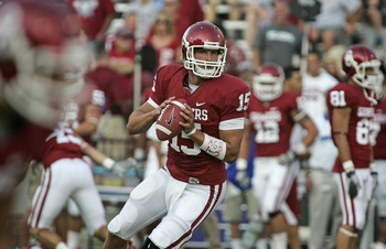 NORMAN, OK - SEPTEMBER 03:   Quarterback Drew Allen #15 warms up before the game against the Tulsa Hurricanes September 3, 2011 at Gaylord Family-Oklahoma Memorial Stadium in Norman, Oklahoma.  Oklahoma defeated Tulsa 47-14.  (Photo by Brett Deering/Getty