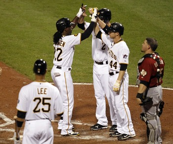PITTSBURGH, PA - SEPTEMBER 07:  Andrew McCutchen #22 of the Pittsburgh Pirates celebrates his three-run home run with Brandon Wood #2 and Alex Presley #44 against the Houston Astros during the game on September 7, 2011 at PNC Park in Pittsburgh, Pennsylva
