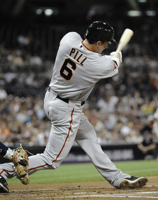 SAN DIEGO, CA - SEPTEMBER 6:  Brett Pill #6 of the San Francisco Giants hits a two-run homer during the second inning of a baseball game against the San Diego Padres at Petco Park on September 6, 2011 in San Diego, California.  (Photo by Denis Poroy/Getty