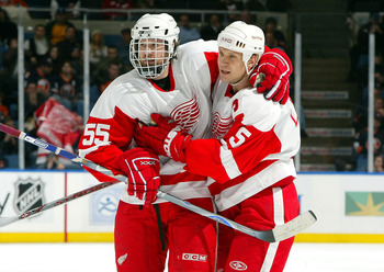 UNIONDALE, NY - JANUARY 30:  Nicklas Lidstrom #5 of the Detroit Red Wings celebrates his game tying goal against the New York Islanders with teammate Niklas Kronwall #55 on January 30, 2007 at Nassau Coliseum in Uniondale, New York.  (Photo by Jim McIsaac