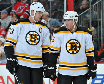 NEWARK, NJ - OCTOBER 16: Zdeno Chara #33 and Johnny Boychuk #55 of of the Boston Bruins talk during the first period against the New Jersey Devils at the Prudential Center on October 16, 2010 in Newark, New Jersey. (Photo by Christopher Pasatieri/Getty Im