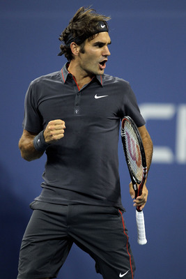 NEW YORK, NY - SEPTEMBER 08:  Roger Federer of Switzerland reacts against Jo-Wilfried Tsonga of France during Day Eleven of the 2011 US Open at the USTA Billie Jean King National Tennis Center on September 8, 2011 in the Flushing neighborhood of the Queen