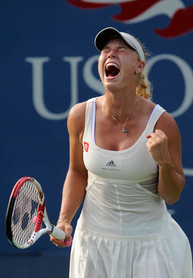 NEW YORK, NY - SEPTEMBER 08:  Caroline Wozniacki of Denmark celebrates winning match point against Andrea Petkovic of Germany during Day Eleven of the 2011 US Open at the USTA Billie Jean King National Tennis Center on September 8, 2011 in the Flushing ne
