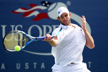NEW YORK, NY - SEPTEMBER 08:  Andy Roddick of the United States returns a shot against David Ferrer of Spain on court 13 during Day Eleven of the 2011 US Open at the USTA Billie Jean King National Tennis Center on September 8, 2011 in the Flushing neighbo