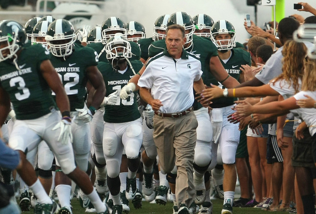 EAST LANSING, MI - SEPTEMBER 02:  Head coach, Mark Dantonio leads his Michigan State Spartans onto the field before an NCAA football game against the Youngstown State Penguins at Spartan Stadium on September 2, 2011 in East Lansing, Michigan.  (Photo by D