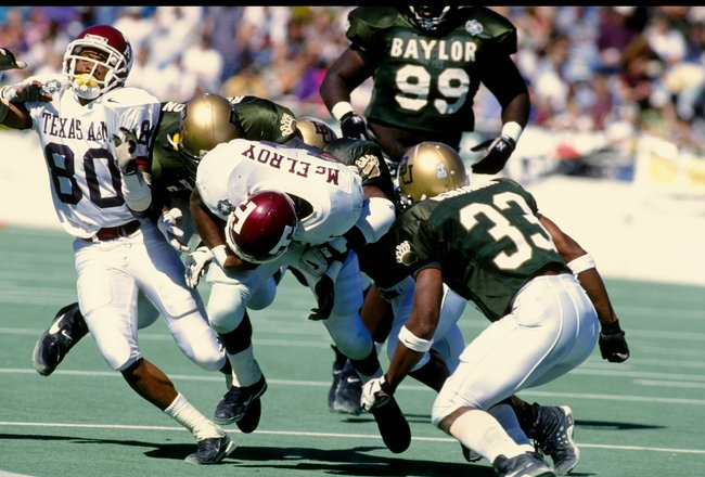 21 OCT 1995:  TEXAS A&M RUNNING BACK LEELAND MCELROY IS BEING TACKLED FROM BEHIND BY THE BAYLOR DEFENSE DURING THE AGGIES 24-9 VICTORY OVER THE BAYLOR BEARS AT KYLE FIELD IN COLLEGE STATION, TEXAS.  MANDATORY CREDIT:  ROBERT SEALE/ALLSPORT USA