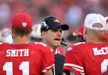 SAN FRANCISCO, CA - AUGUST 20:  Head coach Jim Harbaugh of the San Francisco 49ers talks to his team during their game against the Oakland Raiders at Candlestick Park on August 20, 2011 in San Francisco, California.  (Photo by Ezra Shaw/Getty Images)