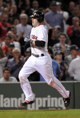 BOSTON, MA - SEPTEMBER 1: Dustin Pedroia #15 of the Boston Red Sox runs the bases in the fourth inning against the New York Yankees at Fenway Park on September 1, 2011 in Boston, Massachusetts. The Yankees won the game 4-2. (Photo by Darren McCollester/Ge