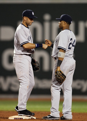 BOSTON, MA - AUGUST 30: Derek Jeter #2 and Robinson Cano #24 of the New York Yankees celebrate the win over the Boston Red Sox on August 30, 2011 at Fenway Park in Boston, Massachusetts. The New York Yankees defeated the Boston Red Sox 5-2. (Photo by Elsa