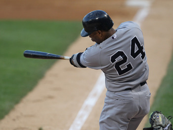 CHICAGO, IL - AUGUST 03:  Robinson Cano #24 of the New York Yankees hits a three-run home run in the 1st inning against the Chicago White Sox at U.S. Cellular Field on August 3, 2011 in Chicago, Illinois.  (Photo by Jonathan Daniel/Getty Images)