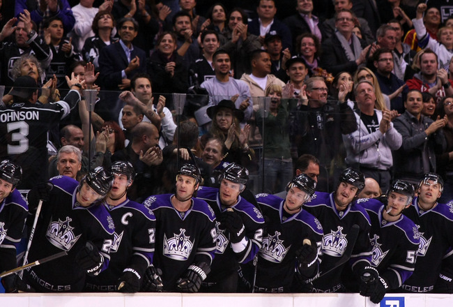 LOS ANGELES, CA - MARCH 21:  The Los Angeles Kings stand in the bench area after a goal by teammate Jarret Stoll #28 (not in photo) against the Calgary Flames in their NHL game at Staples Center on March 21, 2011 in Los Angeles, California. The Kings defe