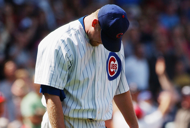 CHICAGO, IL - JULY 24:  Kerry Wood #34 of the Chicago Cubs reacts after giving up a grand slam home run to Bobby Abreu of the Philadelphia Phillies with no outs in the sixth inning of the game on July 24, 2003 at Wrigley Field in Chicago, Illinois.  The P