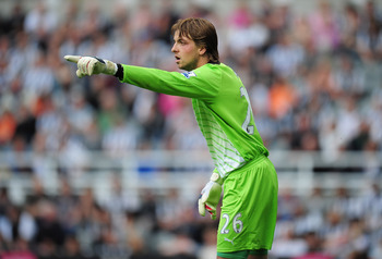 NEWCASTLE UPON TYNE, ENGLAND - AUGUST 13:  Goalkeeper Tim Krul of Newcastle United gives instructions during the Barclays Premier League match between Newcastle United and Arsenal at St James' Park on August 13, 2011 in Newcastle upon Tyne, England.  (Pho