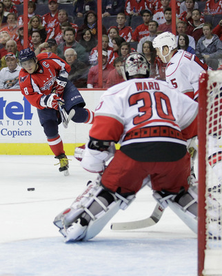 WASHINGTON, DC - MARCH 29:  Alex Ovechkin #8 of the Washington Capitals shoots on goalie Cam Ward #30 of the Carolina Hurricanes during the first period at the Verizon Center on March 29, 2011 in Washington, DC.  (Photo by Rob Carr/Getty Images)