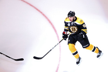BOSTON, MA - JUNE 13:  Brad Marchand #63 of the Boston Bruins celebrates after scoring a goal in the first period against Roberto Luongo #1 of the Vancouver Canucks during Game Six of the 2011 NHL Stanley Cup Final at TD Garden on June 13, 2011 in Boston,