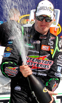 BROOKLYN, MI - AUGUST 21:  Kyle Busch, driver of the #18 Interstate Batteries Toyota, celebrates in Victory Lane after winning the NASCAR Sprint Cup Series Pure Michigan 400 at Michigan International Speedway on August 21, 2011 in Brooklyn, Michigan.  (Ph