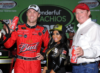 RICHMOND, VA - SEPTEMBER 10:  Kevin Harvick, driver of the #29 Budweiser Chevrolet, celebrates with TV personality Nicole 'Snookie' Polizzi and team owner Richard Childress after winning the NASCAR Sprint Cup Series Wonderful Pistachios 400 at Richmond In